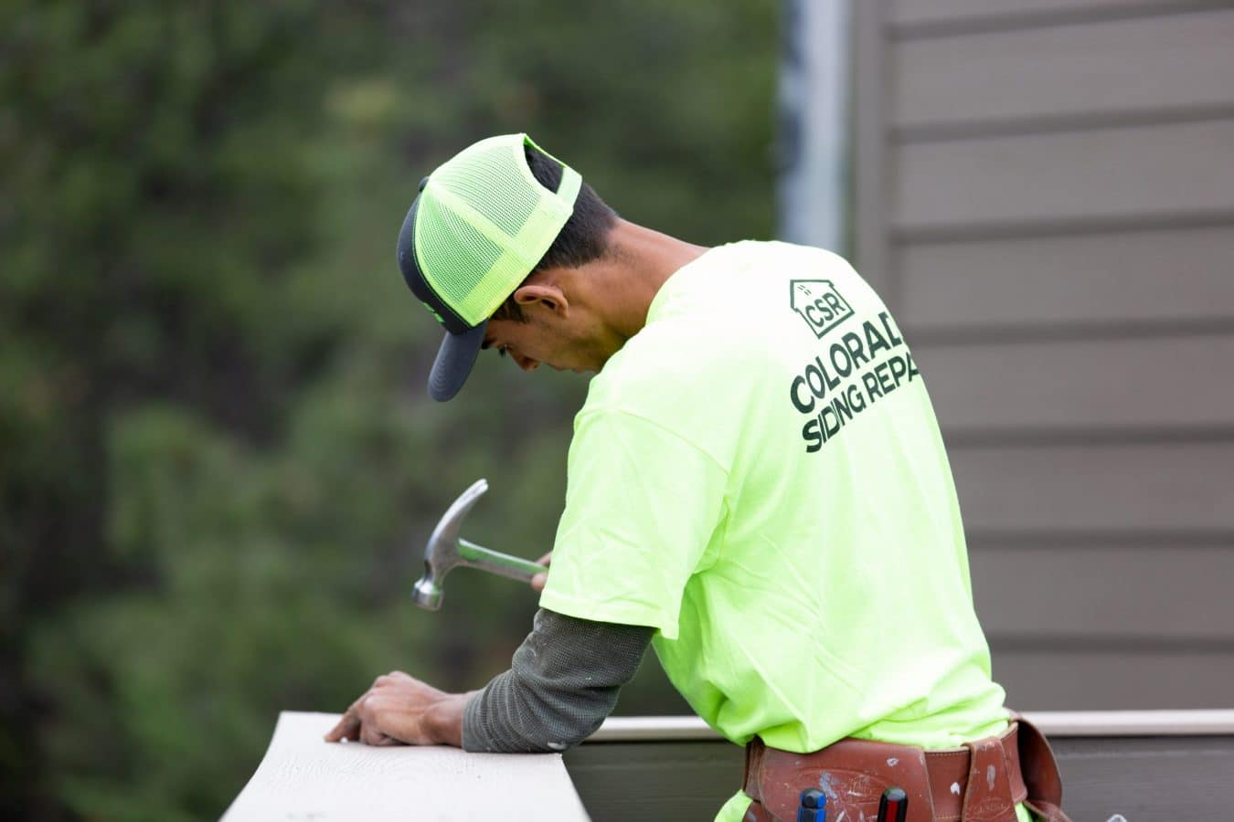 Colorado Siding Repair employee working on a project